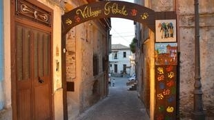 Welcome gate reads 'Global Village' in italian