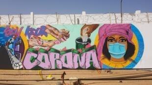 fresque murale de sensibilisation, lutte contre le Covid-19 au Sénégal.