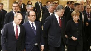 Vladimir Poutine, François Hollande, Petro Porochenko et Angela Merkel, le 11 février 2015 à Minsk en Biélorussie.