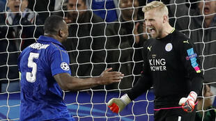 Leicester City goalkeeper Kasper Schmeichel (right) celebrates with teammate Wes Morgan after beating Sevilla on Tuesday.
