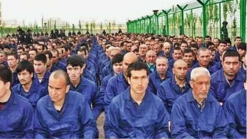 "Detainees in a Xinjiang ""Re-education"" camp."