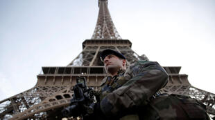 A French soldier stands guard under the Eiffel Tower, as France officially ended a state of emergency regime, replacing it with the introduction of a new security law, in Paris, France, November 1, 2017.