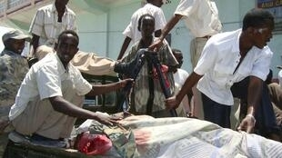 Soldiers and civilians transport a victim of fighting in Mogadishu