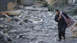 A Palestinian on the site of a home destroyed by Israeli bombardment Wednesday