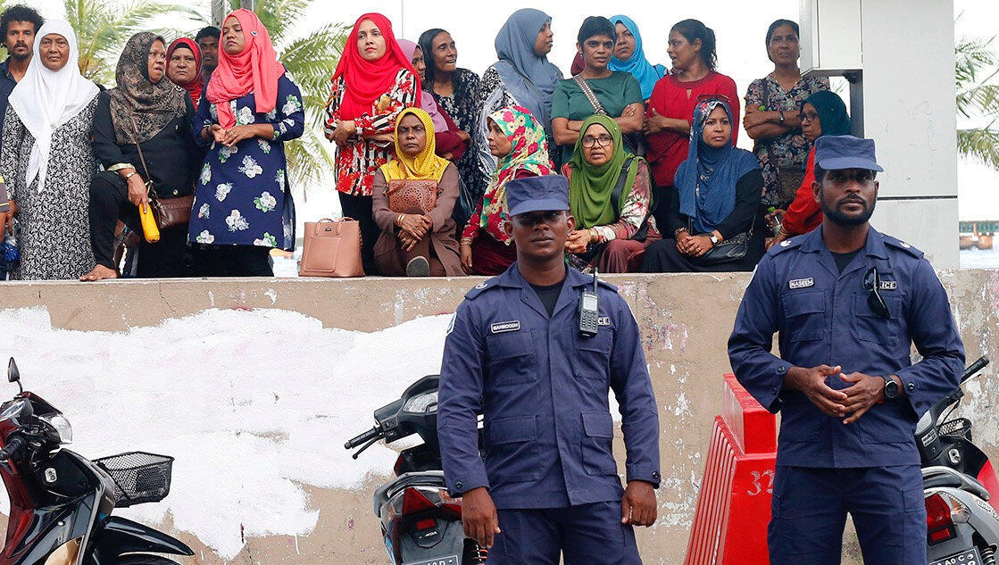 Maldivian police officers stand guard near the MDP (Maldives Democratic Party) opposition party headquarters