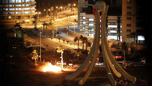 Burning tents are seen in Pearl Square after security forces evacuated anti-government protesters in Manama