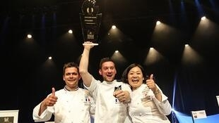 Fabien Degoulet (centre) won the title of the world's best cheesemonger on Sunday in Tours.