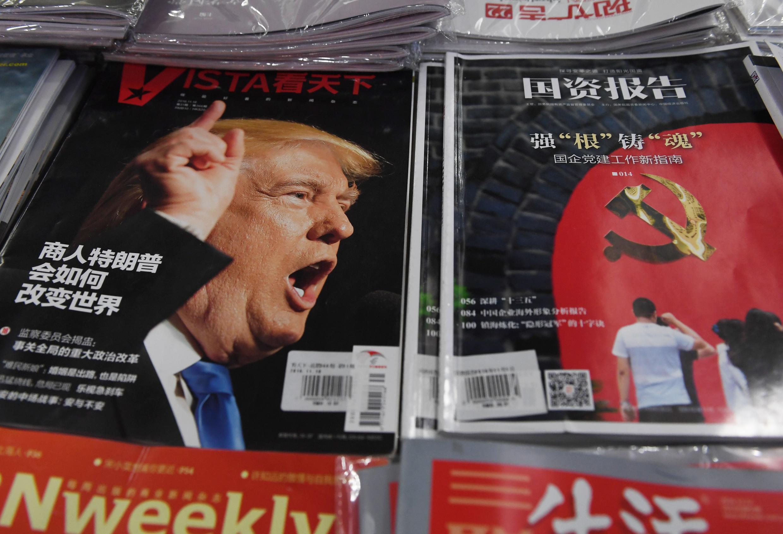 Donald Trump, trên tạp chí ở Trung Quốc và dòng chữ '' Doanh nhân Donald Trump sẽ thay đổi thế giới như thế nào''. Ảnh 12/12/2016.