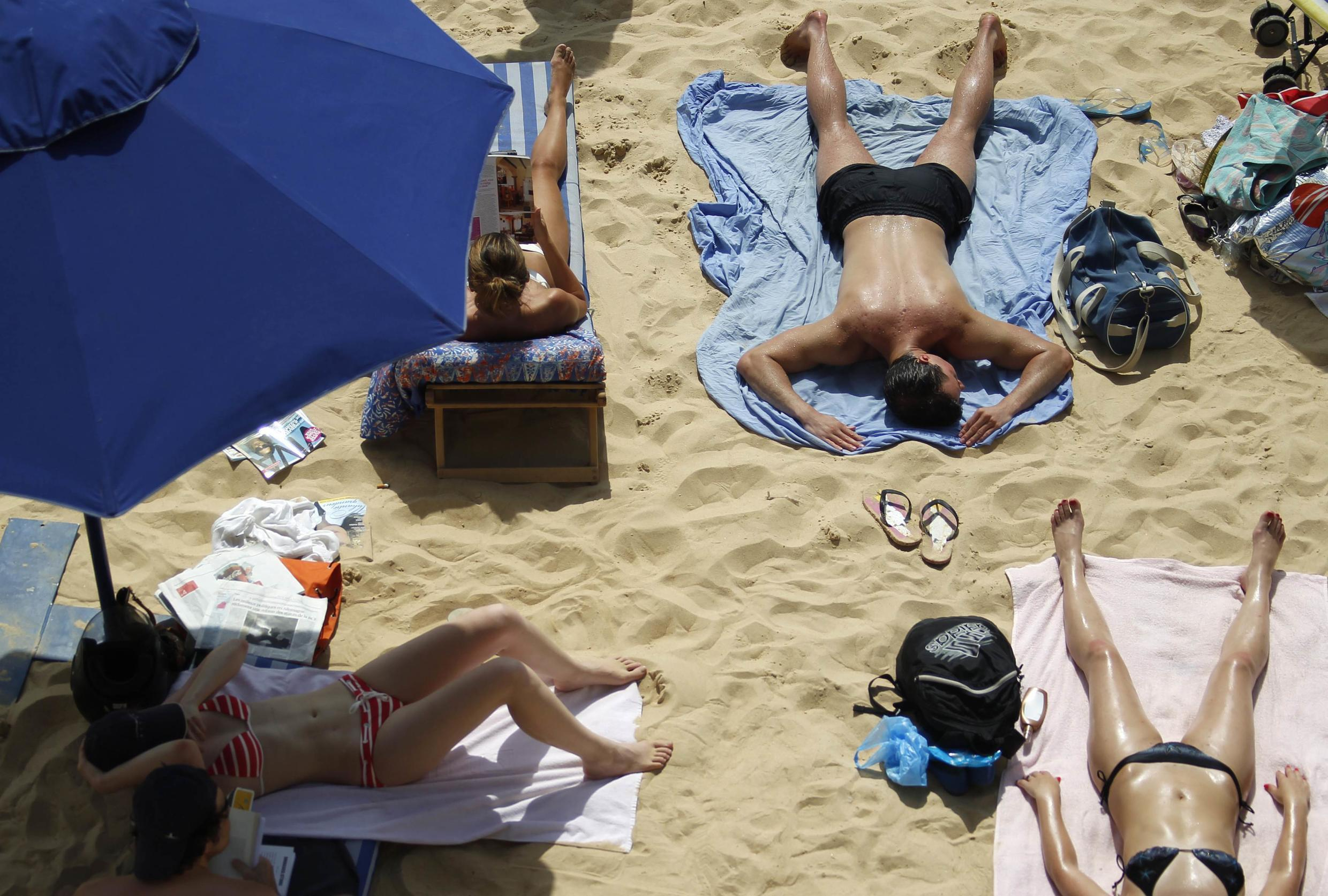 August is the tradition month for holidays in France. But taking time off is not an option for people struggling financially.