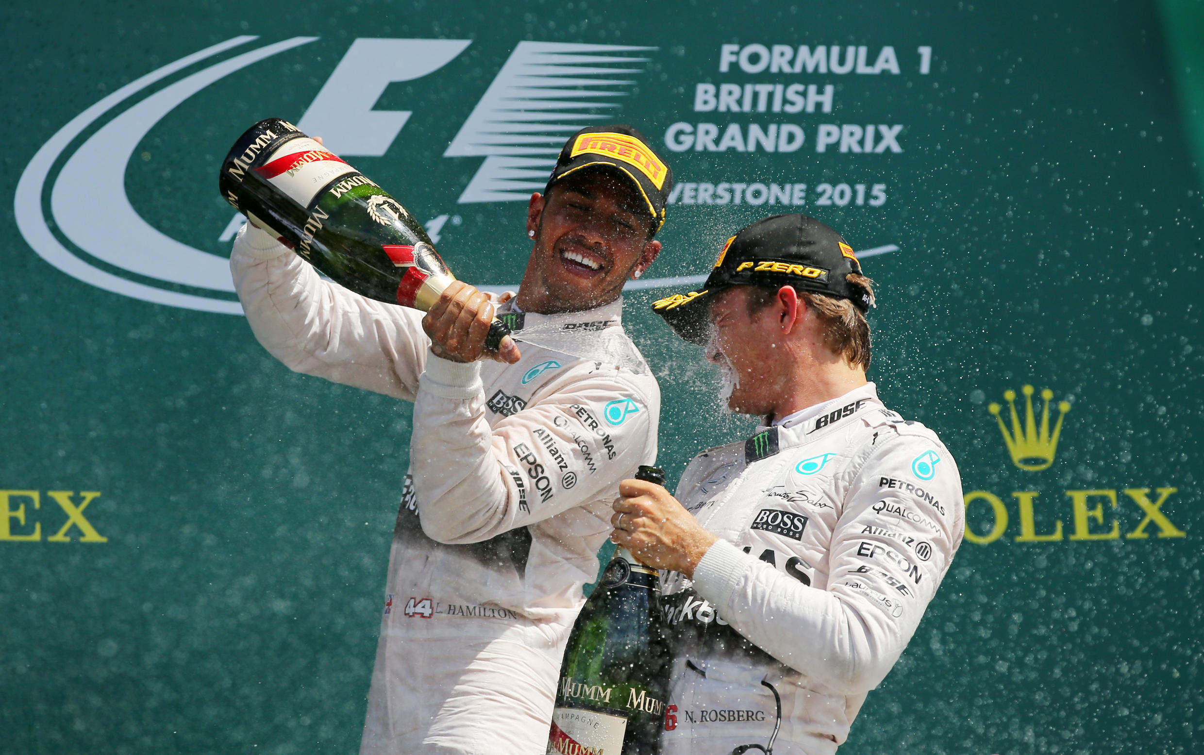 Lewis Hamilton (left) and Nico Rosberg celebrate after finisihing 1st and 2nd at the British Grand Prix on Sunday.