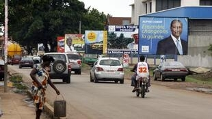 Campaign posters in Conakry ahead of the first round of voting.