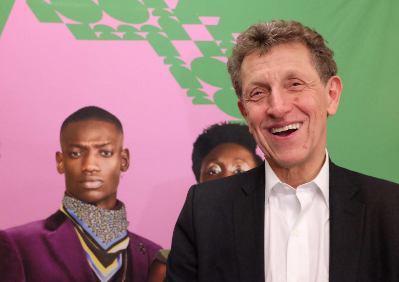Pierre Buhler, président de l'Institut français, devant l'affiche de la saison « Africa 2020 ».