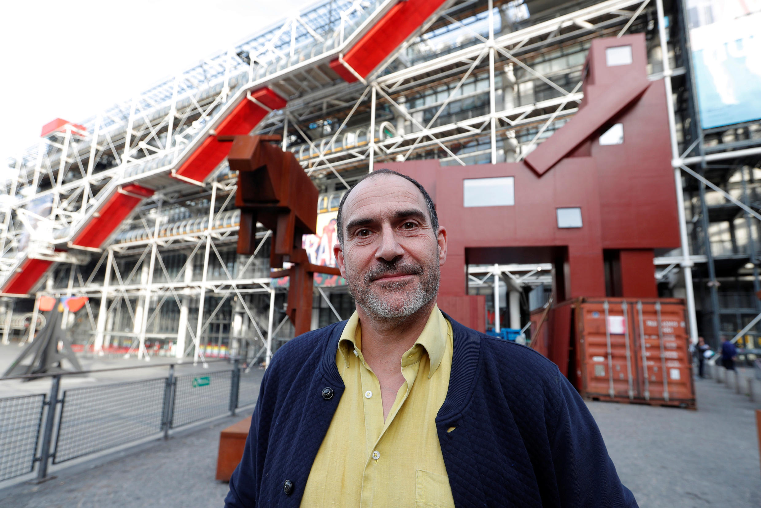 """Dutch artist Joep van Lieshout and his """"Domestikator"""" in front of the Centre Pompidou"""