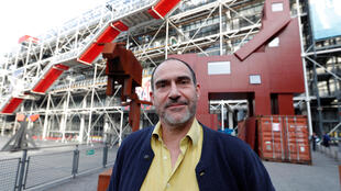 "Dutch artist Joep van Lieshout and his ""Domestikator"" in front of the Centre Pompidou"