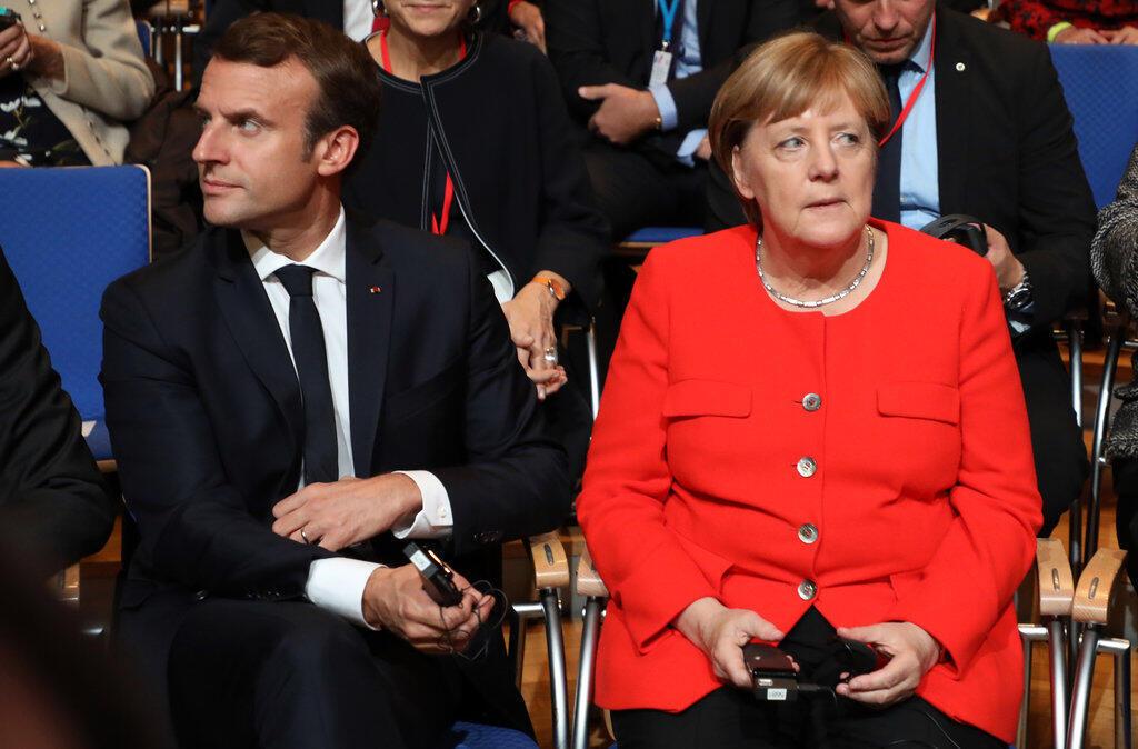圖為法國總統馬克龍與德國總理默克爾於2017年10月。