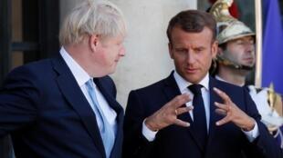 Primeiro-ministro britânico, Boris Johnson, acolhido em Paris pelo presidente francês, Emmanuel Macron, a 22 de Agosto de 2019.22/08/2019.