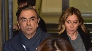 Former Nissan Chairman Carlos Ghosn (L) and his wife Carole (R) leave the office of his lawyer in Tokyo.