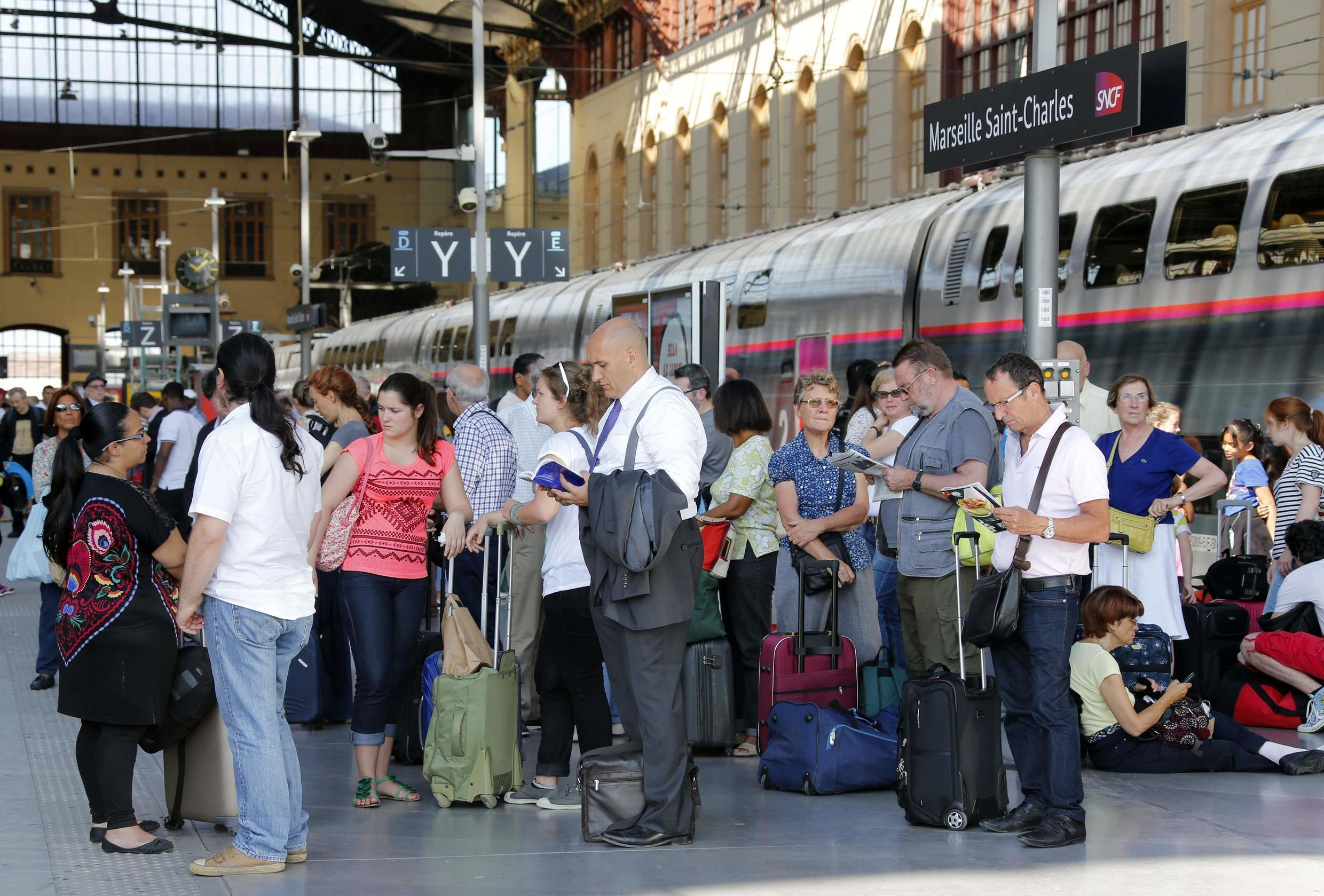 Passengers on a platform of Marseille's central station on Thursday