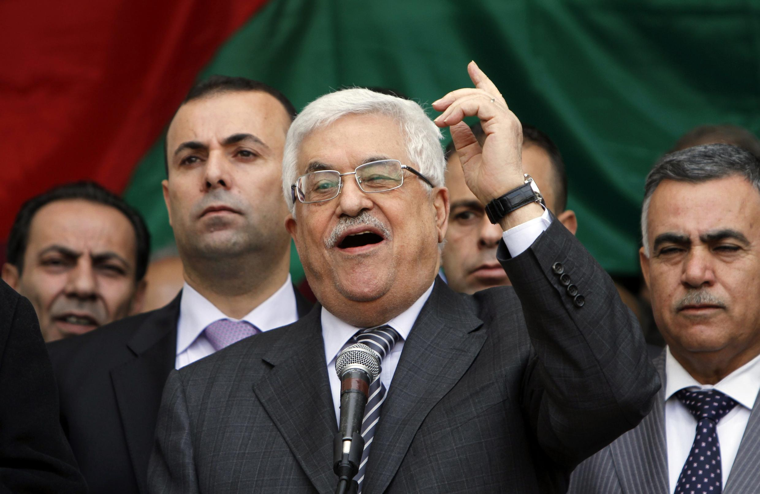 Palestinian President Mahmoud Abbas addresses the crowd during a rally in support of his efforts to secure a diplomatic upgrade at the United Nations, in the West Bank city of Ramallah
