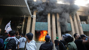 Supporters of Iraq's Hashed al-Shaabi burn down the Kurdistan Democratic Party headquarters in the capital Baghdad