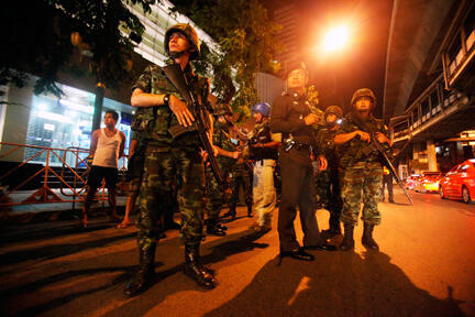 Thai security forces inspect the site of the attacks