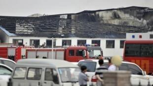 Lực lượng cứu hộ tiếp tục tìm kiếm nạn nhân tại lò mổ gia cầm ở Đức Huệ, tỉnh Cát Lâm, Trung Quốc, ngày 03/06/2013