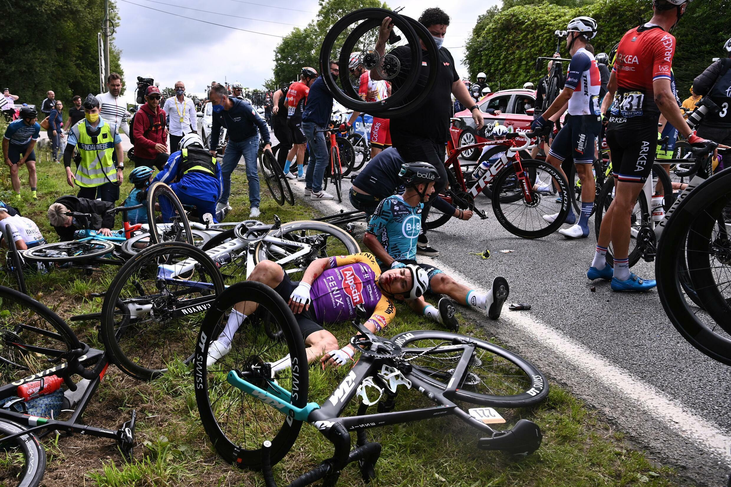A 31-year-old Tour de France spectator who caused dozens of riders to fall after she leant onto the road while brandishing a sign faces a fine of up to €15,000 and a year in prison.