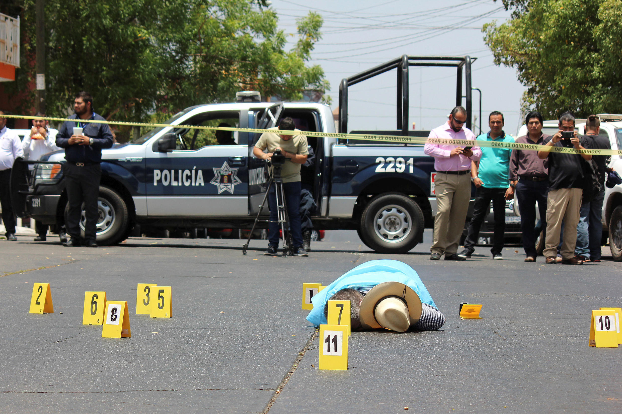 The crime scene in Culiacan, Mexico. Evidence is collected near the body of Mexican journalist Javier Valdez.