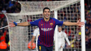Luis Suarez scored twice in Barcelona's 3-0 win at Real Madrid in the Copa del Rey to make it three goals in two games following a five match streak without scoring.