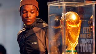 A fan in Khayelitsha township, near Capetown, admiring the World Cup trophy