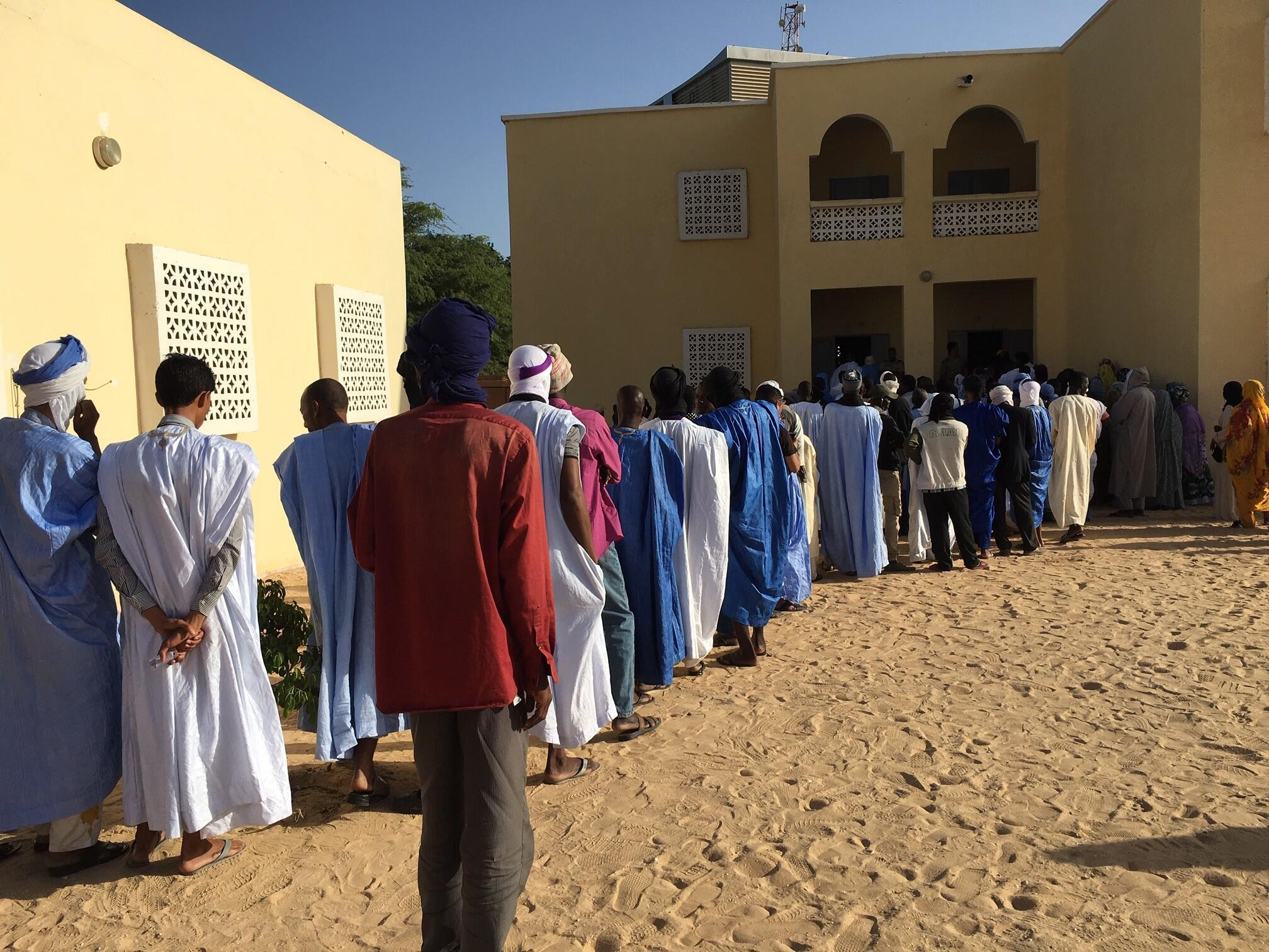 Voters queue at the voting station in Mauritania's presidential elections on Saturday June 22
