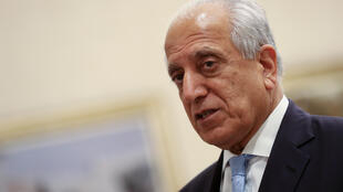 Veteran US diplomat Zalmay Khalilzad was to meet with both sides in negotiations between the Afghan government and the Taliban on a trip to the Qatari capital Doha