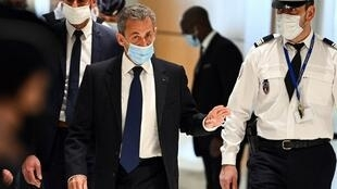 Nicolas Sarkozy arriving in court to hear the verdict in his corruption trial.