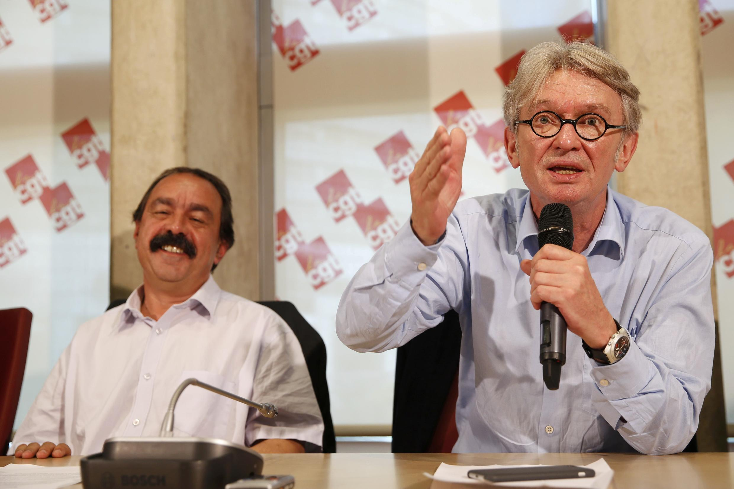 Philippe Martinez  of the CGT (L) and FO'sJean-Claude Mailly (R) at a press conference last year