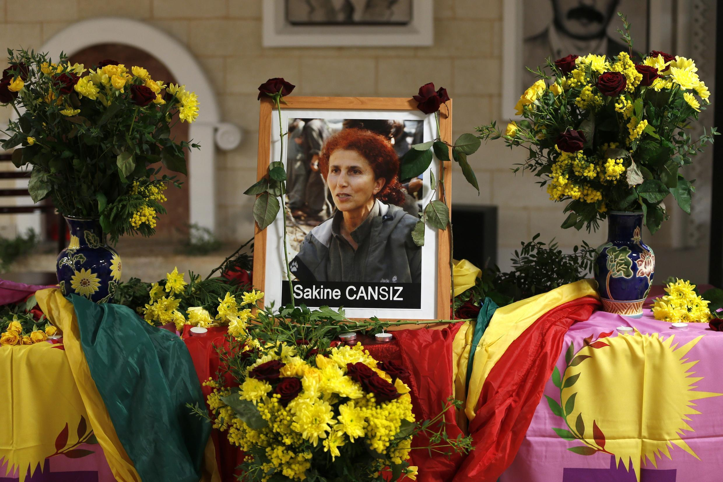Portrait of Sakine Cansiz in front of the Kurdish cultural centre where she was killed in 2013