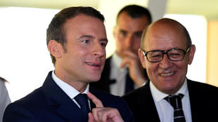 French President Emmanuel Macron (L) and Europe and Foreign Affairs Minister Jean-Yves Le Drian visit the regional operational search and rescue centre (CROSS) in Etel, France, June 1, 2017.