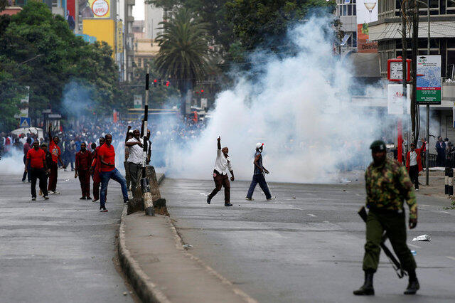 Tear gas fired by Kenyan riot police to disperse supporters of Kenya's President Uhuru Kenyatta is seen during clashes with supporters of Kenyan opposition National Super Alliance (NASA) coalition, during a protest in Nairobi