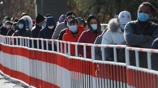 Residents line up to be tested for coronavirus in Beijing on January 11, 2021, after new cases emerged in the province which surrounds the capital