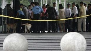 Security officers inspect belongings of employees after a bomb threat at Philippine Stock Exchange