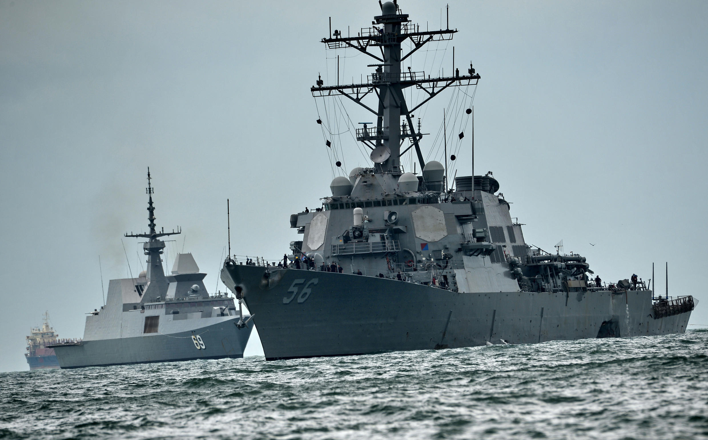 The USS John S. McCain (R), pictured here in 2017, sailed through the Taiwan Strait on Thursday