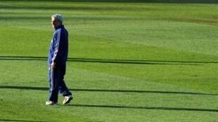 French coach Raymond Domenech, alone, on the French team's training pitch, at  Knysna.