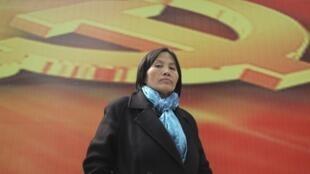 Ảnh nhà hoạt động nhân quyền Tào Thuận Lợi trả lời báo chí tại Bắc Kinh ngày  23/03/ 2013,