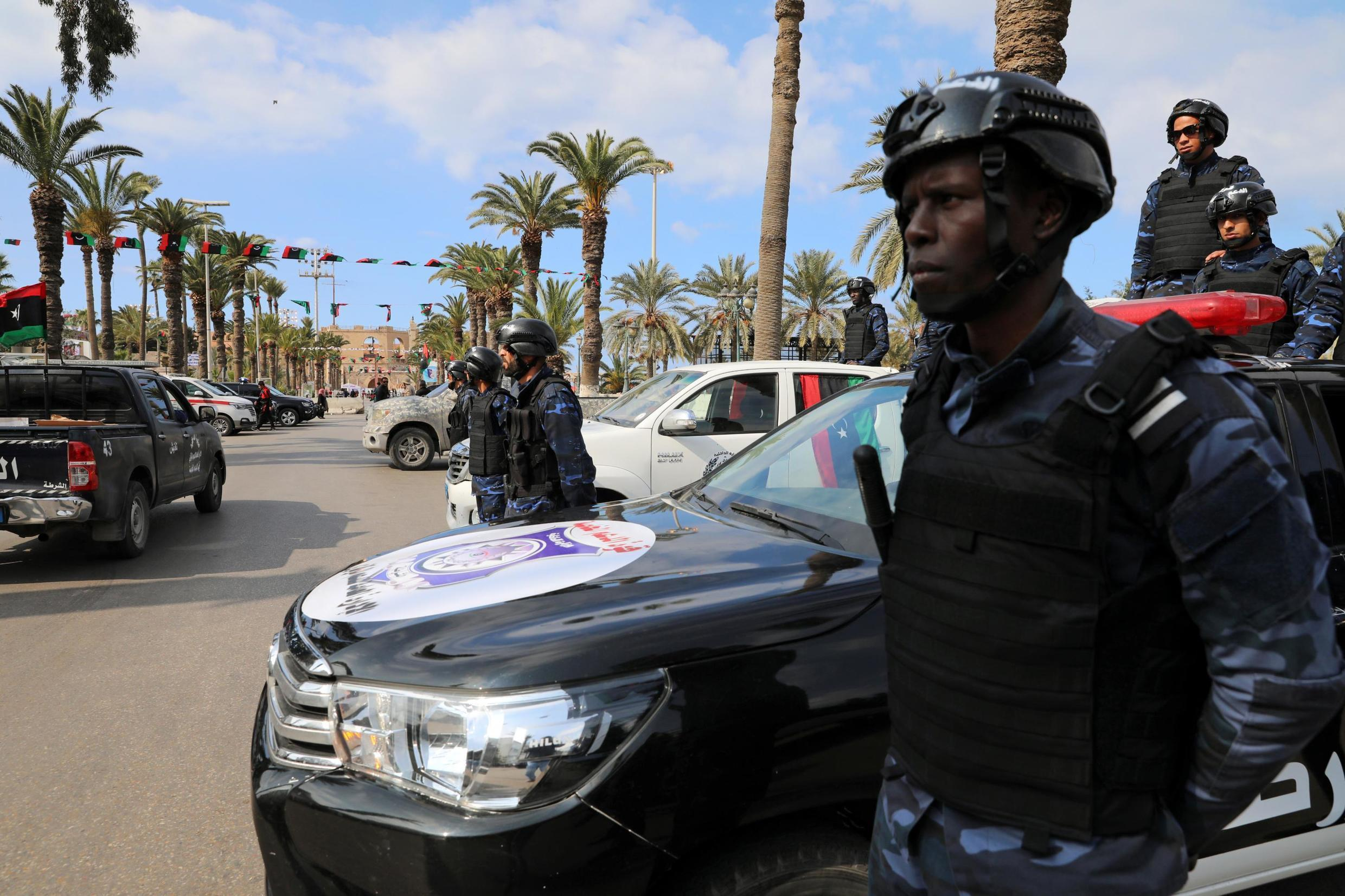 Security forces stand guard during a celebration of the 9th anniversary of the revolution against former Libyan leader Muammar Gaddafi at Martyrs' Square in Tripoli, Libya February 17, 2020