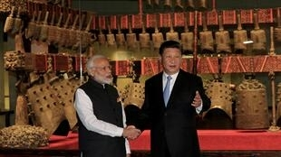 "Xi Jinping and Indian Prime Minister Narendra Modi shake during their first ""informal summit"" in China April 27, 2018."