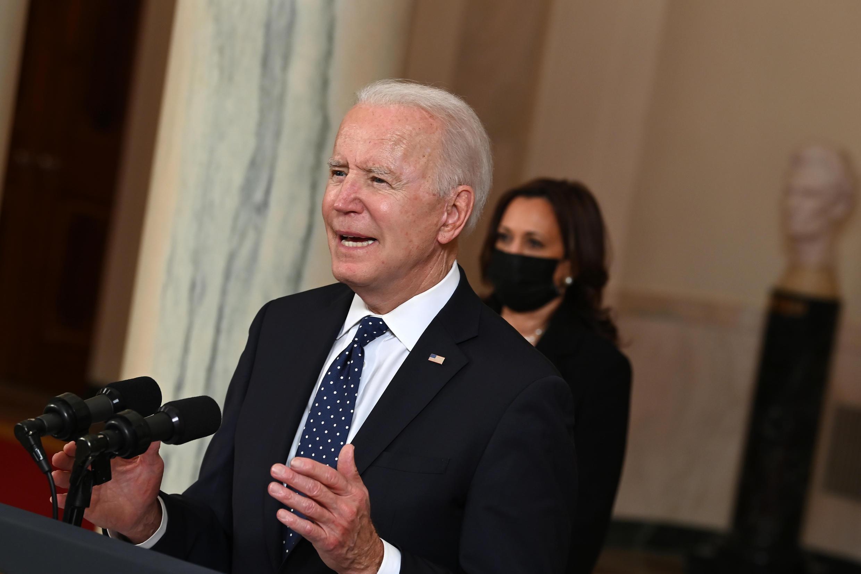 Vice President Kamala Harris  listens as US President Joe Biden speaks on the guilty verdict against former policeman Derek Chauvin
