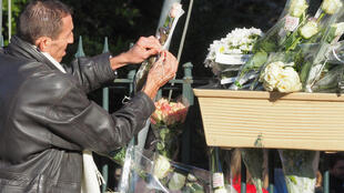 A resident pays tribute to the victims at Saint-Feliu-D'Avall