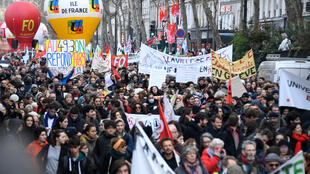 Demonstration in Paris against article 49-3 of the constitution that would allow the government to push through its pension reforms.