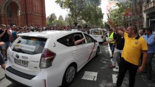 Le conflit entre les taxis et les VTC ne date pas d'hier. Ici une manifestation de chauffeurs de taxi à Barcelone, en juillet 2018.