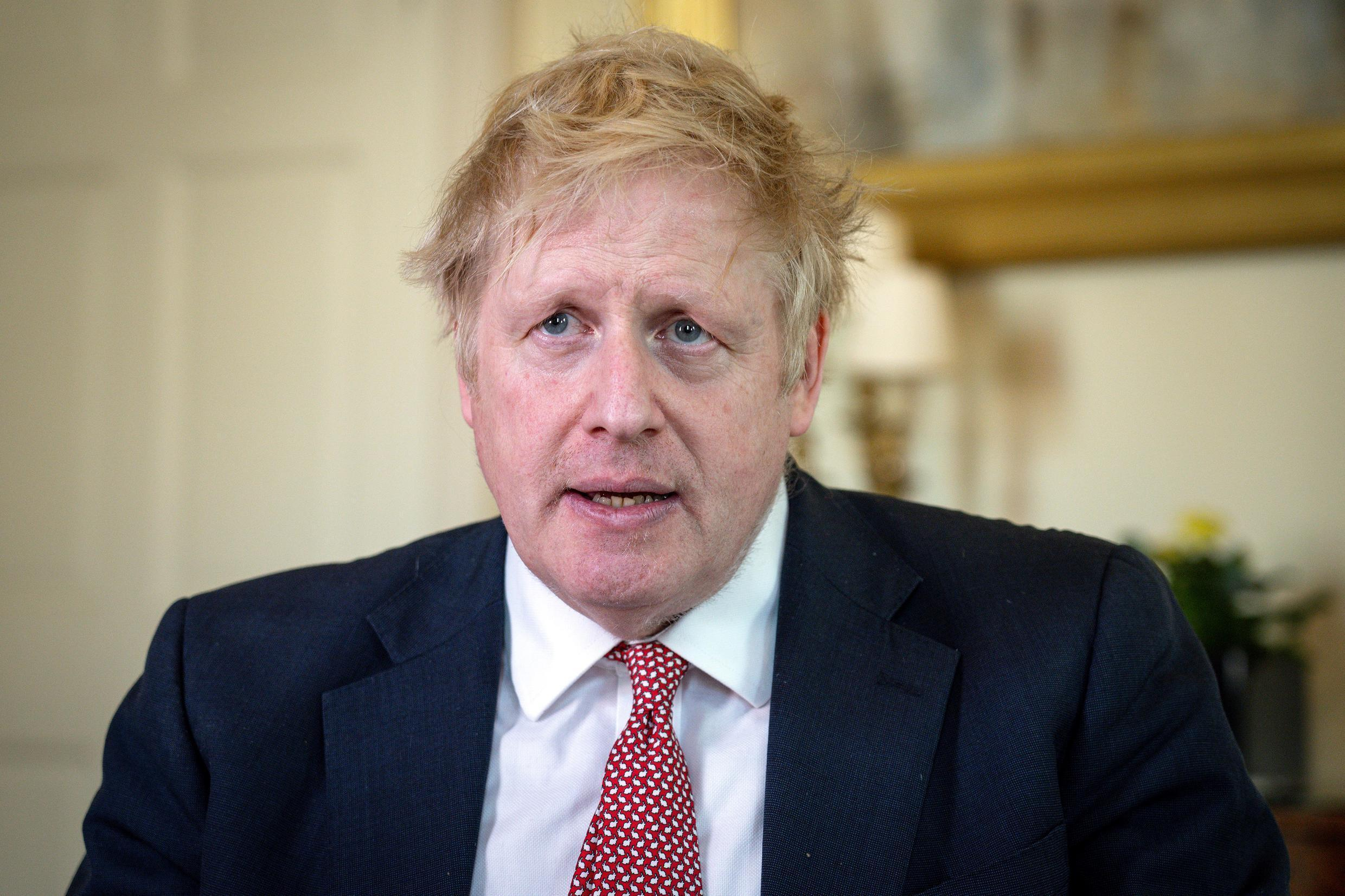 Prime Minister Boris Johnson (picture after he was discharged from hospital on April 12) is expected to return to work Monday after recovering from the coronavirus