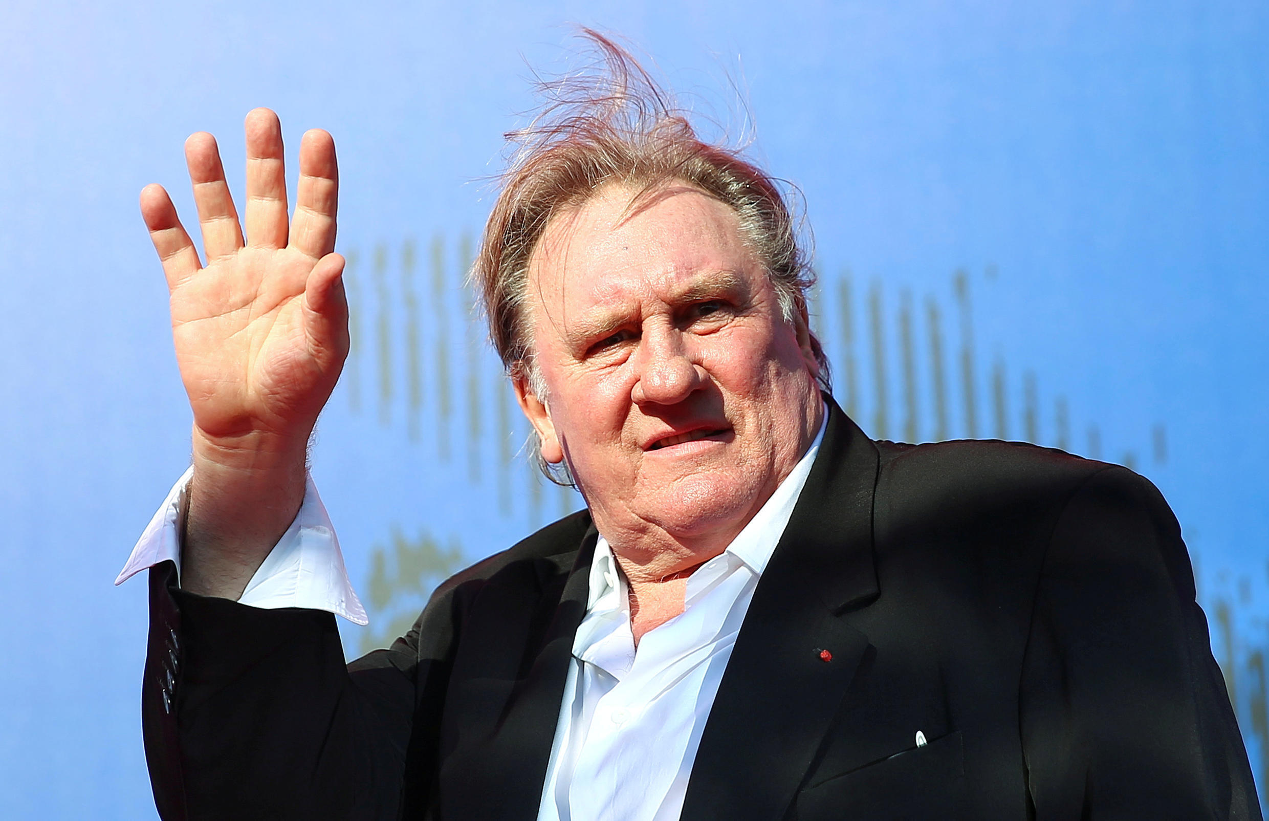 """Gerard Depardieu waves as he arrives during a red carpet event for the movie """"Novecento- Atto Primo"""" at the 74th Venice Film Festival in Venice, Italy, Italy September 5, 2017."""